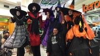 Witches parade on stilts