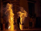 Fire show with stilt walkers
